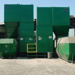 Side by side food waste compactors feeding 40-yard receiver containers.