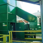 Loading door to dump basket with safety handrails.